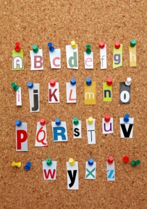 Letters of the alphabet cut out and pinned to a notice board