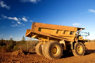 Mining truck on the red sands of Australia against a blue sky