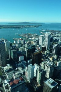 View over Auckland, New Zealand showing tall buildings and ocean beyond