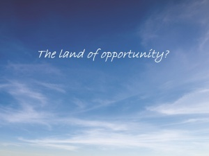 Blue sky with the land of opportunity written across it