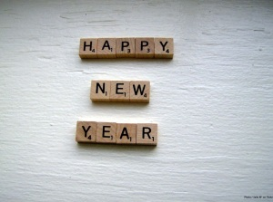 Scrabble tiles spelling out Happy New Year